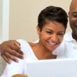 African-American Couple Using Laptop at Home — Stock Video