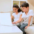 Stock Video: Young Children Playing Games on Laptop
