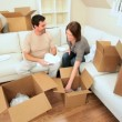 Couple Unpacking House Moving Cartons — Stock Video