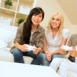Girls Night In Playing Electronic Games - Stock Photo