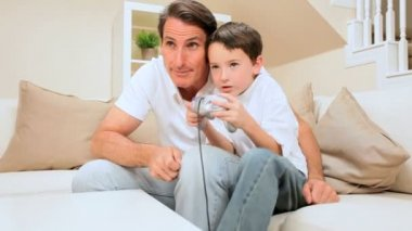 Father & Son Playing Games Console — Stock Video