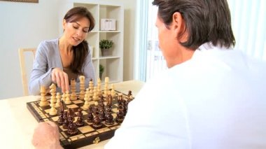 Young Couple Playing Chess at Home — Stock Video