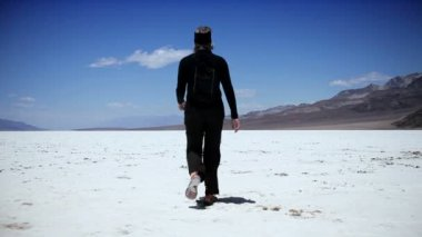 Solitary Figure Crossing a Dry Salt Lake — Stock Video