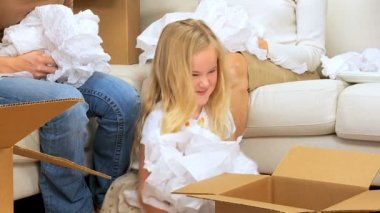 Family Females with Tissue from Moving Cartons — Stock Video