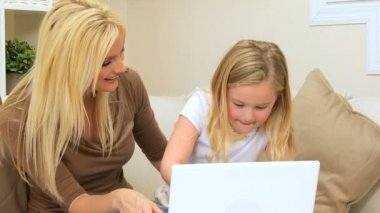 Mom & Young Daughter Using Laptop Computer — Stock Video