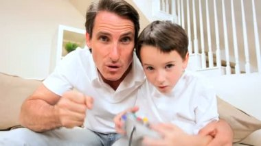 Father & Son Playing Electronic Games — Stock Video