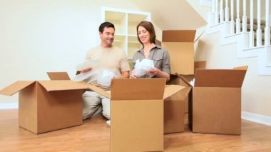 Attractive Couple Surrounded by Moving Boxes — Stock Video
