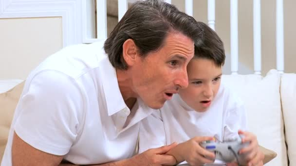 Father & Son Playing on Games Console — Vidéo