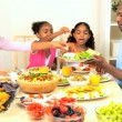 Stock Video: AfricAmericFamily Enjoying Healthy Lunch