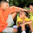 Young Ethnic Family Together Outdoors — Vídeo Stock