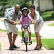 African American Child Practicing on her Bicycle - Stock Photo