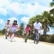 Healthy Ethnic Family Enjoying Cycling Together - Foto Stock
