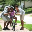 Cute Young Girl Practicing Riding her Bike - Foto de Stock  