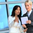 Two Caucasian Businesswomen Using Wireless Tablet — Stock Video