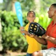 Ethnic Father & Son Practicing Baseball - Stock Photo