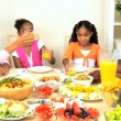 Stock Video: Young Ethnic Family Sharing Healthy Lunch