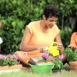 Ethnic Mother & Daughters Gardening Together — Stock Video #23249886