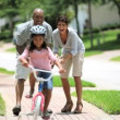 Little African American Girl Learning to Ride a Bike — Stockvideo