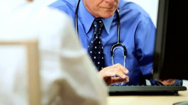 Senior Male Consultant with Patient — Video Stock