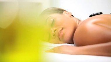 Health Spa Client Relaxing with Hot Stone Therapy — Stock Video