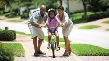 African American Child Practicing on her Bicycle — Stockvideo