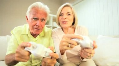 Retired Couple Competing on Games Console — Stock Video