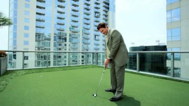 Young Executive Practicing Golf on Office Rooftop — Stock Video