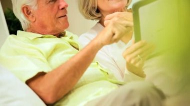 Mature Couple Using a Wireless Tablet — Stock Video