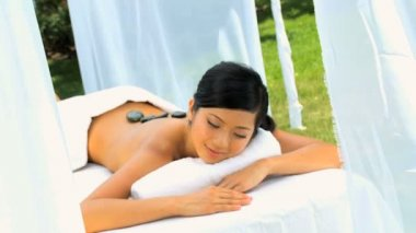 Female Spa Client Receiving Hot Stone Therapy — Stock Video