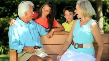 Caucasian Grandparents Being Visited by Grandchildren — Stock Video