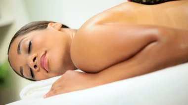 Female Spa Client Receiving Hot Stone Spa Massage — Stock Video