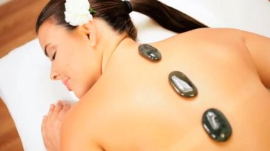 Caucasian Girl Relaxing with Hot Stone Spa Therapy — Stock Video