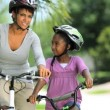 Royalty-Free Stock Vector Image: EthnicMother & Daughter Bike Riding Together