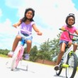 Little African American Girls on Bicycles — Stock Video #23250102