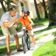 African American Child Practicing on his Bicycle - Stock Photo
