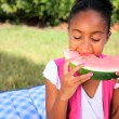 Little African American Girl Eating Fresh Fruit — Stock Video
