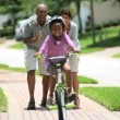 Royalty-Free Stock Vektorgrafik: Little African American Girl Learning to Ride a Bike