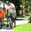 Ethnic Father & Son on Bicycles — Stock Video #23250750