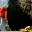 Stock Video: Young Female on Hiking Expedition by Waterfall