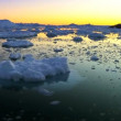 Sun setting over glacier ice — Stock Video