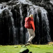 Stock Video: Female Hiker Stopping at Waterfall