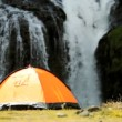 Stock Video: Hiker & Her Tent by Cascading Waterfall