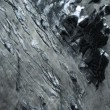 Stock Video: Aerial View of Icelandic Glacier & Volcanic Dust