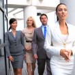 Stock Video: Female Business Executives Leading Team to Meeting