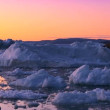 Stock Video: Arctic Sunset & Moon Shining on Melting Ice
