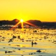 Stock Video: Arctic Sunset over Frozen Landscape