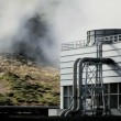Stock Video: Geothermal Power Station in Barren Landscape
