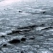 Stock Video: Aerial View of Ice Glacier with Volcanic Ash, Iceland