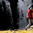 Vídeo de stock: Lone Female on Hiking Expedition by Waterfall