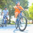 Young Ethnic Family Cycling Together — Video